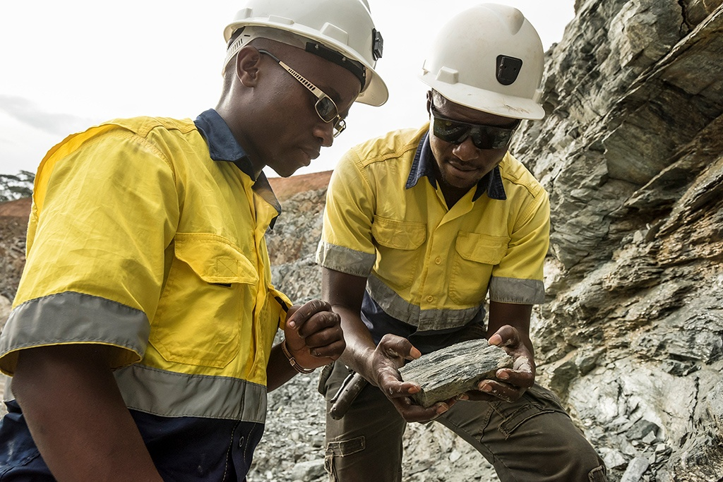 Geologists at Kibali inspecting rock samples.